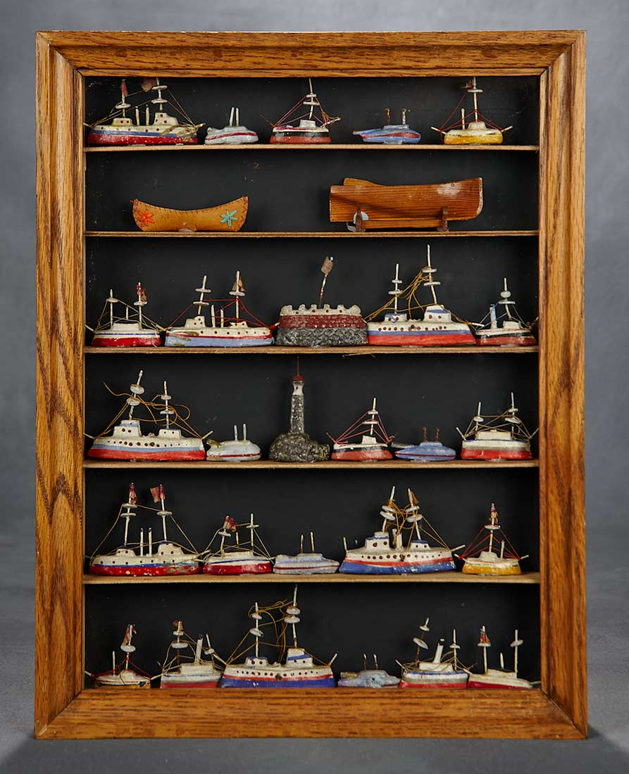 Collection Of Miniature Wooden Toy Boats In Display Cabinet